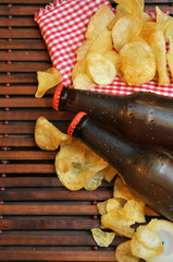 bottles of cold beer and chips