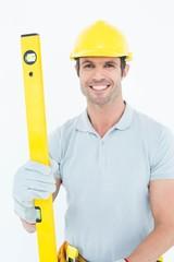 Male carpenter holding spirit level