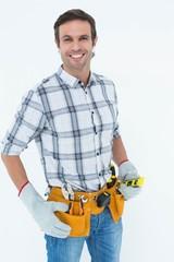 Confident technician holding spirit level