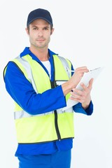 Confident supervisor writing notes on clipboard