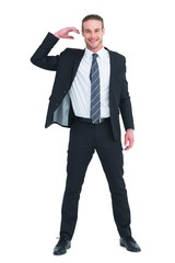 Happy businessman posing and gesturing