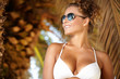 Portrait of attractive female wearing stylish sunglasses hug pal