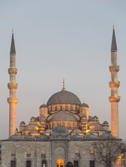 Yeni Cami mosque at sunset in Istanbul, cloudy sky