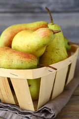 Juicy pears in wooden box