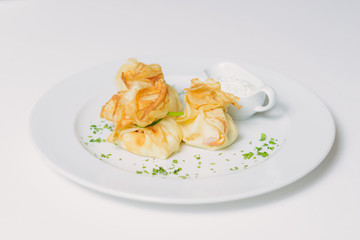 Pancakes with salmon, sour cream and greens