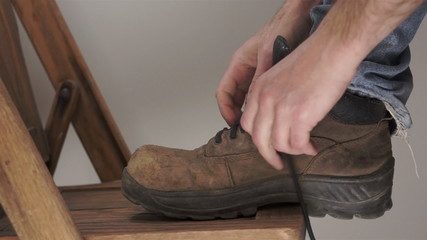 Man Putting On Workboot