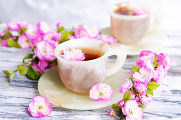 Beautiful fruit blossom with cup of tea