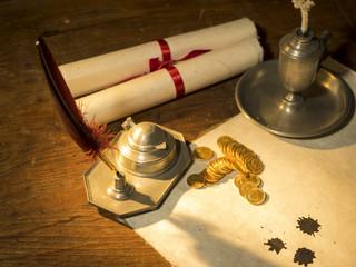 Antique parchment paper sheets lit by candlelight