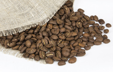 Coffee beans spilled out of the bag. White background. Isolated.