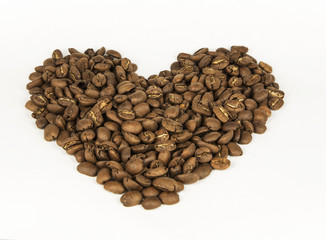 Heart, lined with coffee beans. White background. Isolated.