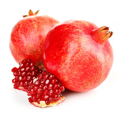 Juicy ripe pomegranates, isolated on white