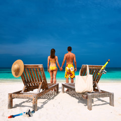 Couple in yellow on a beach at Maldives