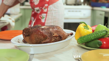 Baked duck on wooden table. Popular christmas dish