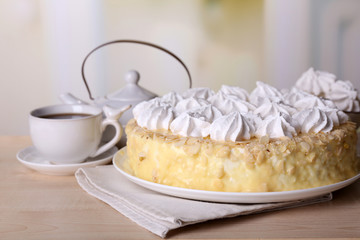 Tasty homemade meringue cake and cup of tea