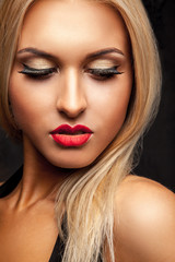 Portrait of beauty blonde female looking down in studio with pro