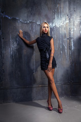 Full length photo of blonde woman in short dress looking away an
