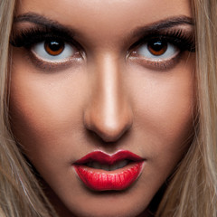 Close up portrait of beautiful blonde woman with make up