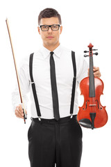 Male violinist holding violin and a wand