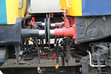 The Connectors and Buffers of Two Train Carriages.
