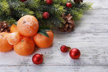 Christmas composition with tangerines on wooden background