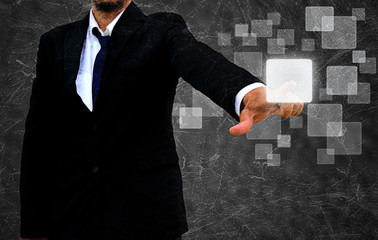 businessman hand pushing button on a touch screen interface in t