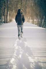 Female and footsteps in snow