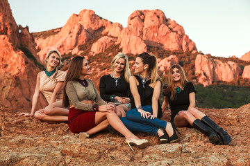 Pretty young women sitting in the rock to fashion photography