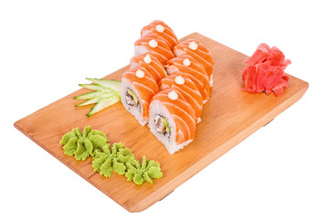 Surprisingly tasty delicious sushi on a wooden board
