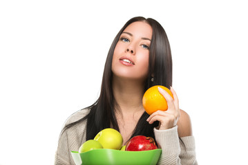 attractive brunette woman with  bowl of fruit on  white