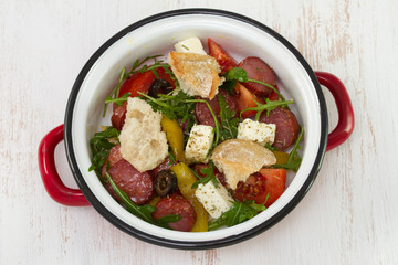 salad with chorizo, cheese and bread