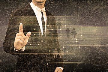 Businessman holding social network in the old texture