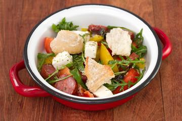 salad with chorizo and bread