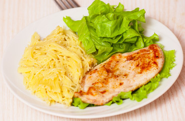 chicken breast with pasta and salad