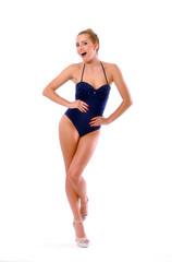 Smiling cute girl posing in blue swimming suit