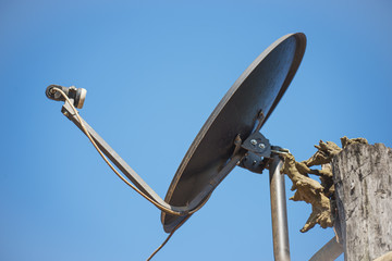Black satellite antenna dish on the roof