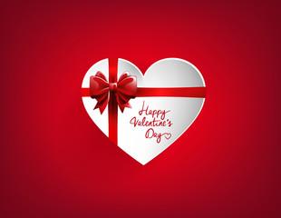 Corazón blanco con lazo rojo de regalo. Día de San Valentín