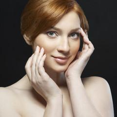 Redhead woman on dark background