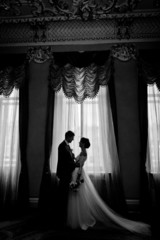 silhouette of beautiful newlyweds in luxury interior