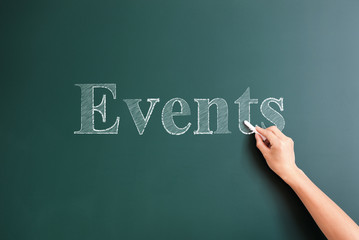 events written on blackboard
