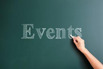 events written on blackboard
