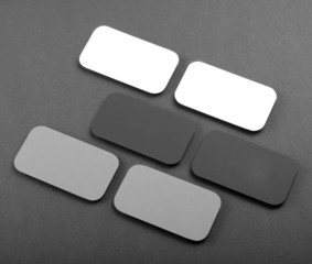 blank business cards with rounded corners on a gray background