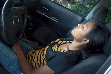 woman is sleeping in a car