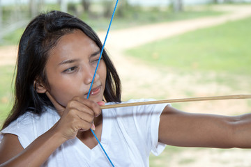 girl practicing archery