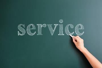 service written on blackboard