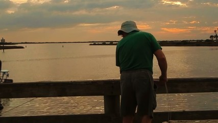 fisherman looking for crabs over dock
