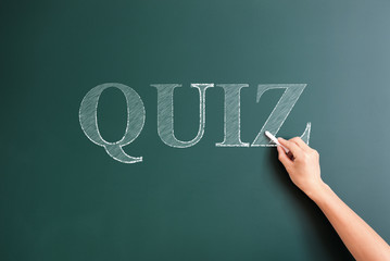 quiz written on blackboard