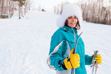 Attractive young female on a ski resort half-length portrait
