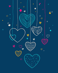 Hanging hearts on dark background.