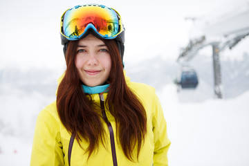 Woman on the background of snow winter and mounts.