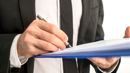Business man signing a contract or document on a map